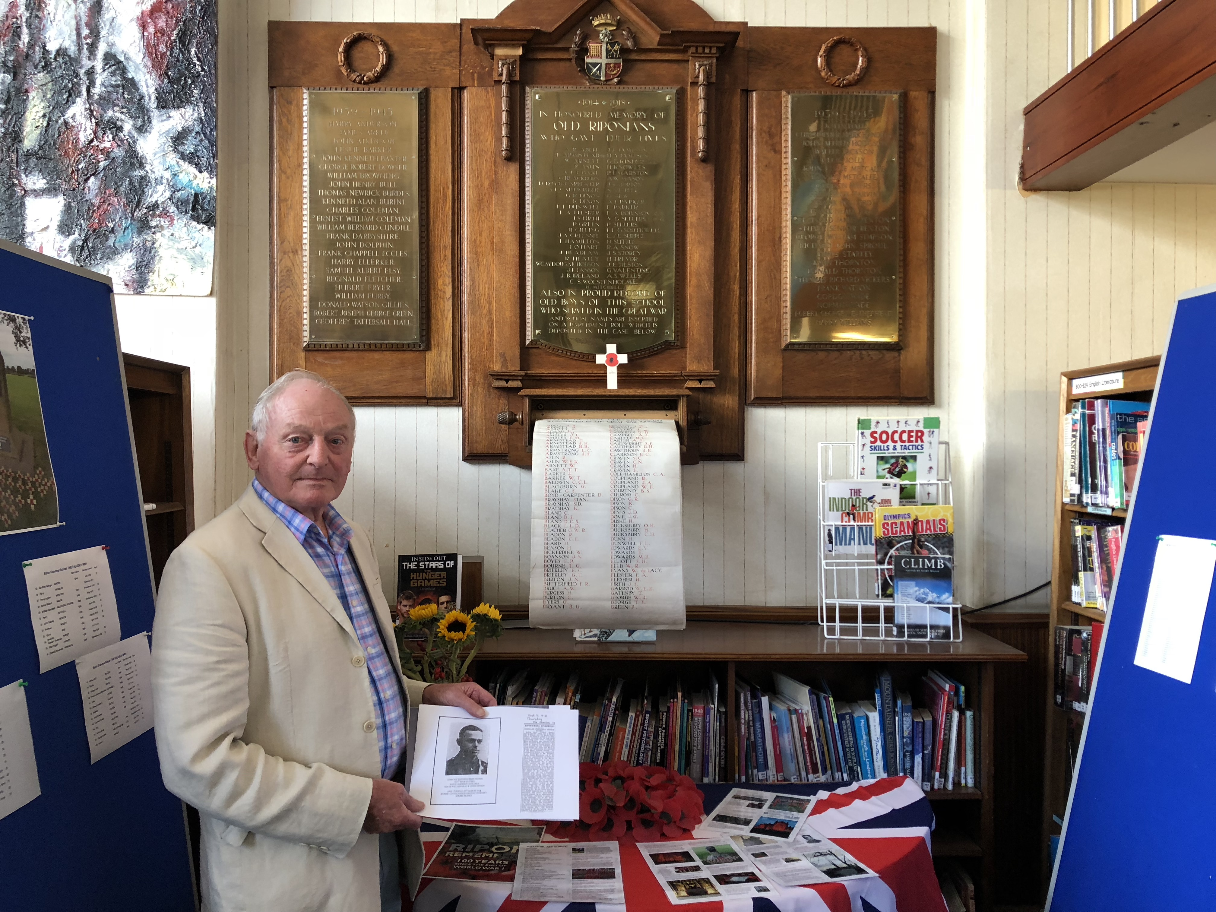Peter Benson in front of the Roll of Honour